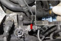 Working at the oil filter housing, remove the 19mm VANOS oil line banjo bolt (red arrow).