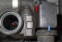Filling and bleeding cooling system: Open the reservoir vent (red arrow).