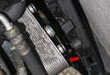 Pull the transmission oil cooler off the radiator (red arrow).