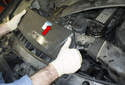 Push the fresh air plenum toward the firewall (red arrow) to remove from the radiator support.