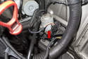 With the intake air ducts and housing remove, you now have access to the heater control valve (red arrow).