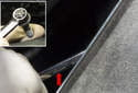 This photo shows the top fastener being removed (red arrow) with an 8mm wrench.