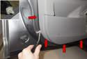 Using a door panel clip tool, release door panel clips (red arrows).