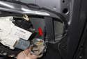 Then remove the door check through the door cavity (red arrow).