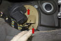 Working at the fan, (inside passenger compartment left footwell) remove the two Phillips head screws (red arrows).