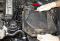 Remove the air filter housing and the intake air ducts (red arrow).