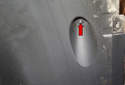 Rear liner: Then, working at the front of the liner, remove the 10mm plastic nut (red arrow).
