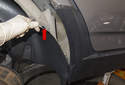 Rear liner: With all the fasteners removed, pull the rear of the liner away from front trim (red arrow).