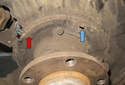Then lightly grease brake shoe to backing plate contact points (red arrows).