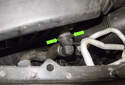 Working at the front of the air filter housing, squeeze the secondary air hose connector (green arrows) to release the locks, then pull it straight off.