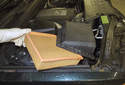 Open the air filter housing lid and remove the air filter.