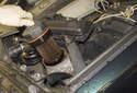 8-cylinder engine: Remove the oil filter cover from the engine and remove the old oil filter from the cover.