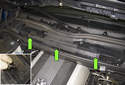 Working at the wiper cowl, rotate each retainer (green arrows) 90° counterclockwise to disengage.
