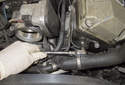 Remove the camshaft position sensor 5mm Allen fastener.