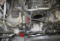 Working at the right front of the engine, remove the vacuum hose (red arrow) from the secondary air valve.