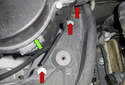 Working at the e-box (green arrow) housing above the right side valve cover, remove the three 10mm fasteners (red arrows).