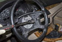 Remove the driver airbag and steering wheel.