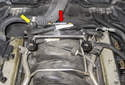 The oil separator is located at the right rear of the intake manifold (yellow arrow), while the crankcase breather is mounted to the rear of the intake manifold (red arrow).