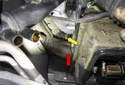 Looking down past the cylinder head between the exhaust manifold (red arrow) and the transmission bell housing, you can see the hose connection (yellow arrow).