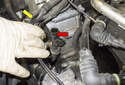 Move the wiring harness (yellow arrow) from the engine side of the dipstick tube (red arrow).