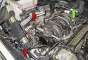 Move the wiring harnesses (red arrows) to the right side of the engine and place it out of the way.
