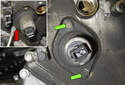 Working at the VANOS solenoid, remove the two 10mm seal fasteners (green arrows).