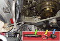 Remove the tensioner (red arrow) from the engine.