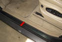 Front trim: The front doorsill is trimmed by one plastic trim piece (red arrow).