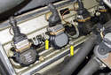 Remove two 10mm ignition coil mounting nuts (yellow arrows).