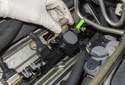 Remove the ignition coil from the cylinder head by pulling straight up (green arrow).