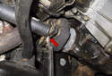 Lever (red arrow) the driveshaft toward the rear of the vehicle to separate it from the flex-disc.