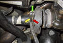 Next, mark the driveshaft (yellow arrow) split flange (green arrow).