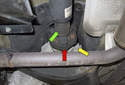 The flex-disc (red arrow) is just out of sight and is tucked above and forward of the transmission cross member, connecting the driveshaft (green arrow) to the transfer case (yellow arrow).