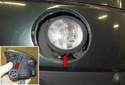 Fog Light: Disconnect the electrical connector from the bulb by squeezing the release tabs (green arrows) and pulling it straight off.