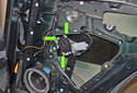Next, remove the three T30 Torx screws holding the window motor to the regulator (green arrows).