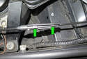 Open the cable junction box by releasing the tabs (green arrows).