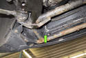 Draining cooling system: Remove the radiator drain plug and drain the coolant (green arrow).