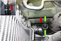 To remove the sensor from the hose, squeeze the plastic locking tabs on the sensor (green arrows) and pull the sensor out of the radiator hose in the direction of the red arrows.