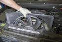 Once the fan is unscrewed from the water pump, remove the fan from the engine compartment with the fan shroud.