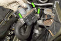 Loosen all three heater hose clamps (green arrows).