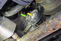 A/C belt tensioner: To replace the pulley, remove the T50 Torx fastener (yellow arrow).