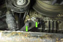 A/C belt tensioner: Then remove the two 13mm tensioner fasteners (green arrows).