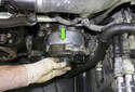 To remove the alternator, slide it straight out of the housing in the direction of the green arrow.
