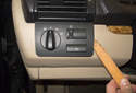 Headlight Switch: Using a plastic prying tool, gently lever out the headlight switch from the dashboard.