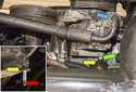 Working from below, on the left side of the engine, remove the pressure line using a 17mm crows-foot wrench (blue arrow).
