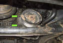 Now, you can remove the two 5mm Allen power steering mounting fasteners (green arrows).