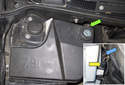 The washer pumps are located at the back of the washer fluid reservoir (green arrow).