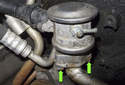 Secondary air pump check valve: Next remove the two 10mm nuts (green arrows) from the bottom of the check valve.