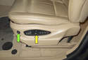 The seat has two main switches, one for lumbar (green arrow) and one for the memory and seat position (yellow arrow).