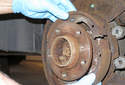 Remove the parking brake shoes from the vehicle and then separate the remaining parts.